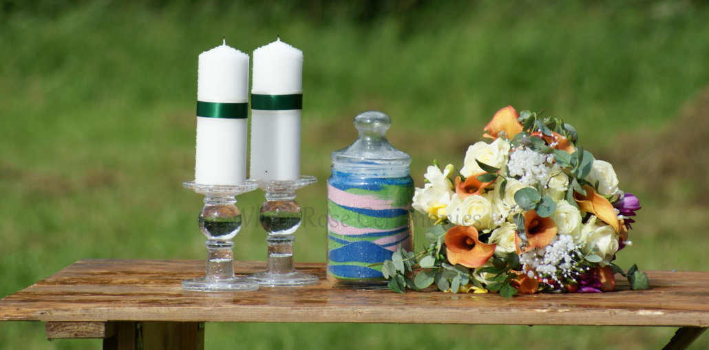 Sand Unity Ceremony jar with candles and flowers