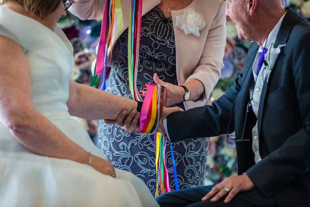 Include different coloured ribbons in a hand tying to remember loved ones